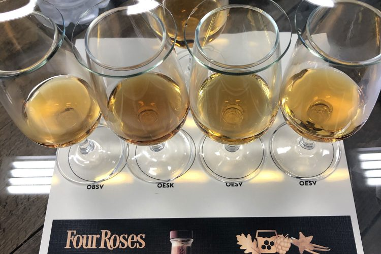 Four batches of mingled Four Roses bourbon in line, and the final result, the 2019 Limited Edition Small Batch, at the top.